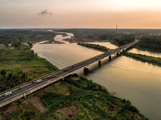 Long bridge aerial view of photo crossing wide river