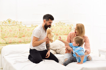 Little boy with dad and mom. happy family and childrens day. little boy play with parents at home. father and mother with child play toys. happy childhood. Care and development. Happy together