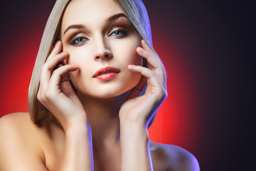 Beautiful Young Woman with Clean Fresh Skin. Perfect Makeup.