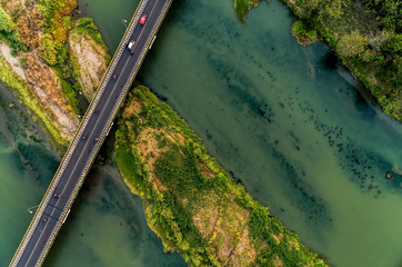 Aerial photography of long bridge top view crossing wide river