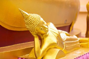 Ancient golden reclining buddha at Big Buddha Temple is a famous tourist destination of Koh Samui island, Surat Thani province, Thailand