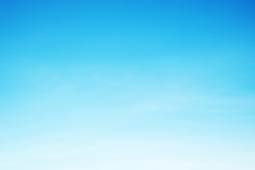Soft white clouds against blue sky background and copy space