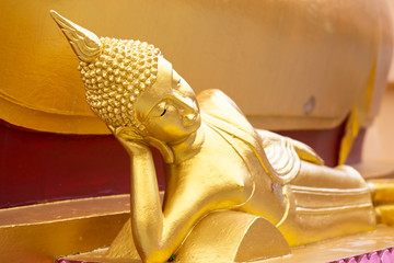 Ancient golden reclining buddha at Big Buddha Temple is a famous tourist destination of Koh Samui island, Surat Thani province, Thailand