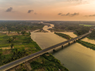 Long Bridge sunset aerial shot with wide river and golden sky