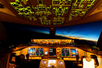 Very beautiful sky view from airplane inside cockpit when airplane fly over the ocean in evening twilight. Seen from the back seat when airplane is turning at high altitude. Modern aviation concept.