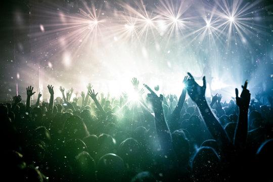 concert crowd, stars and rainbow light
