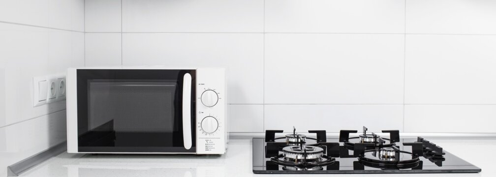 Image of the microwave oven. Modern microwave. Front view.