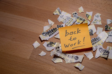 Closeup photo of motivation sticker note on teared up lottery tickets of Power Ball and Mega Millions with copy space