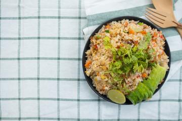 Fried rice with pork on black dish, Thai food