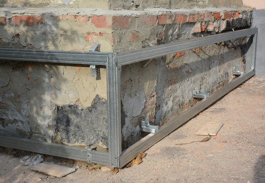 House foundation wall repair and renovation  with installing on frame metal sheets for waterproofing.