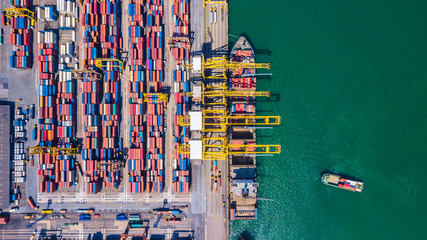 Aerial view of  Deep seaport with cargo ships and containers
