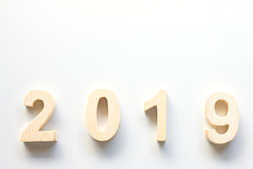 2019 Happy New Year with clock on white table background,Vintage tone,Copy space for your text.