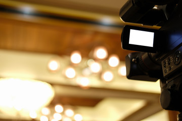 video production camera recording live event on stage. television social media broadcasting seminar conference