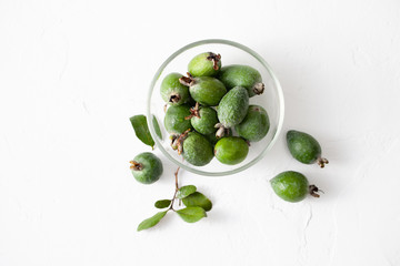 Fresh raw feijoa fruit in a plate on white