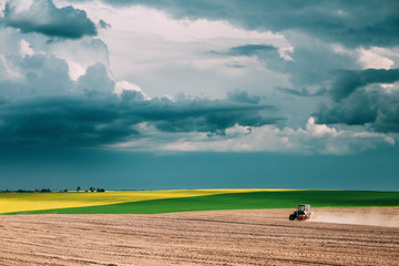 Tractor Plowing Field In Spring Season. Beginning Of Agricultura Wall mural