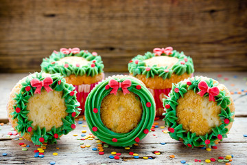 Christmas wreath cupcakes -  beautiful and delicious homemade cupcakes decorated with green cream and candy sprinkles, Christmas and New Year dessert
