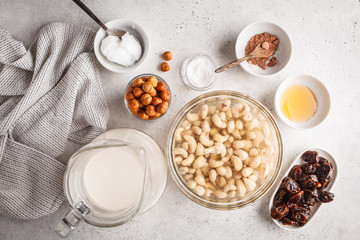 Ingredients for raw vegan cake, cashew cake on a white background.