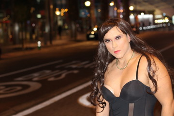 Stunning transgender woman outdoors with copy space