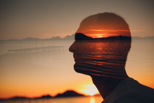 Man, sunset and sea. Psychotherapy concept. Multiple exposure.