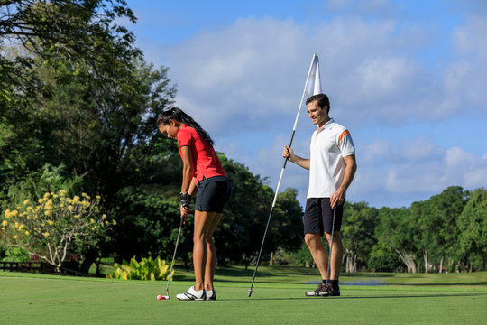 A couple on the golf course
