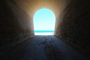 Fototapeten Tunel Inside a tunnel that leads to the sea shore, natural scene, l'Aliga beach, Mediterranean, Catalonia, Costa Dorada, L'Ametlla de Mar, Tarragona, Spain