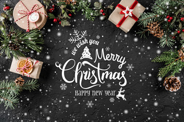Christmas and New Year Typographical on holiday background with Fir branches, gifts, berries. Xmas and Happy New Year theme