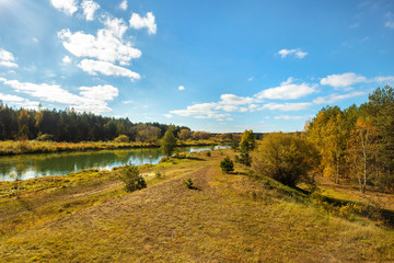 Autumn landscape with bright blue sky and river