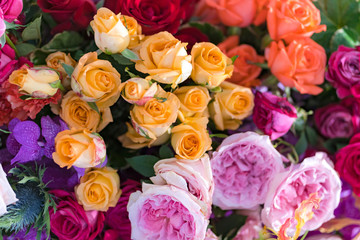 Mixed multi colored roses in floral decor, Colorful wedding flowers background