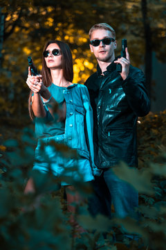 special agents armed with guns in the image of Mr. and Mrs. Smith
