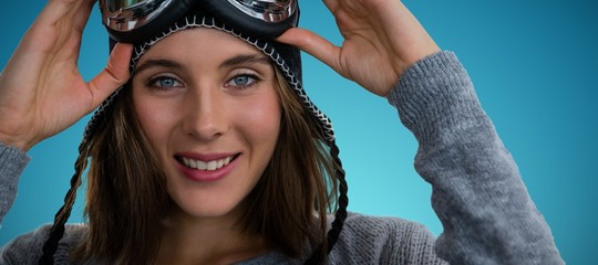 Composite image of portrait of woman with ski goggles