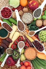Health food for a high fibre diet with fruit, vegetables, legumes, nuts, seeds and cereals. Foods with antioxidants, anthocyanins, vitamins and minerals. Top view.