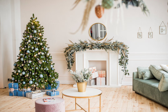 New Year's and Christmas! Beautiful decorations for Christmas, fireplace, tree, toys, gifts, cones, festive lights.