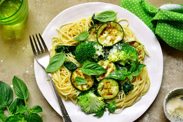 Spaghetti pasta with green vegetables (broccoli, spinach, grilled zucchini) .Top view.
