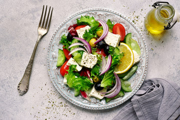Vegetable salad with feta cheese - traditional dish of greek cuisine.Top view.