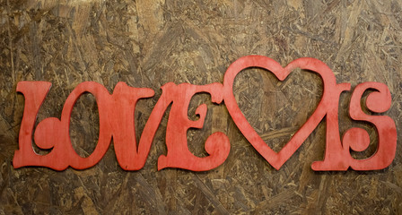 love is on a wooden plate background
