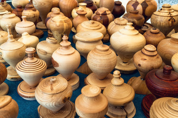 many vintage handcrafted wooden spinning top on a table