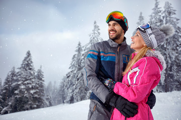 love couple enjoying on winter vacation together on the mountain