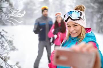 Girl making selfie on skiing