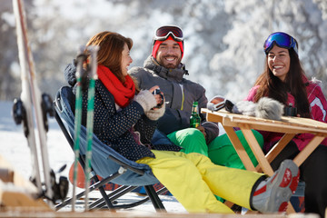 Female and male on skiing enjoy in cafe