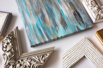 Picture framing. Artwork on canvas and samples of frames.