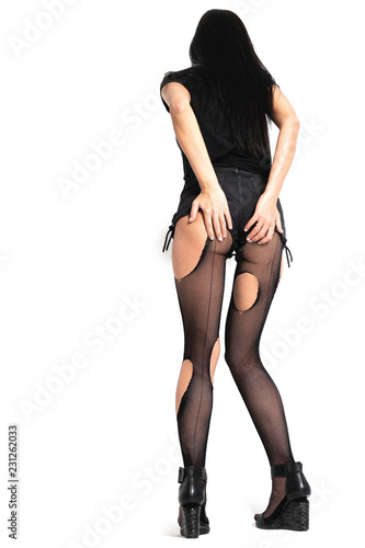 d0cb9b1c452 pantyhose or torn black nylon tights on legs of woman isolated on white  background