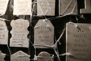 """A tombstone that reads, """"Do not send me Whatsapp messages, I haven't coverage"""", is seen on the facade of a house at """"Noche del Terror"""" (Horror night) during Halloween celebrations in the neighborhood of Churriana, near Malaga"""