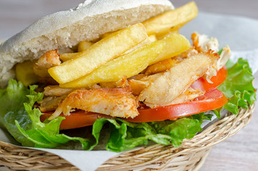 chicken sandwich with potatoes
