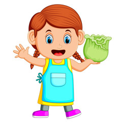 A girl holding fresh cabbage