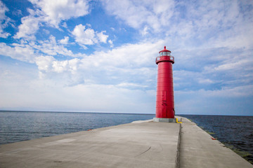 Lighthouse Background With Copy Space. Grand Haven Michigan lighthouse on a sunny day along the coast of Lake Michigan.