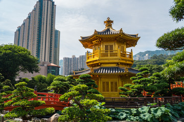 Japanese style Pagoda with busy city behind. beautiful park in Asia, temple