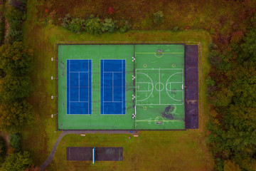 Autumn aerial basketball and tennis