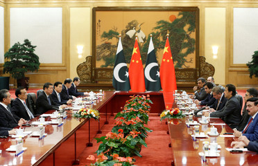 Pakistani Prime Minister Imran Khan and China's Premier Li Keqiang attend a meeting in Beijing