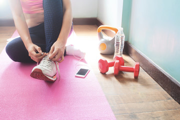 Healthy fit young woman in activewear preparing exercise at home, Healthy concept