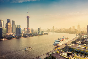 Aerial view on Shanghai, China. Beautiful daytime skyline with skyscrapers and the Hunapu river.